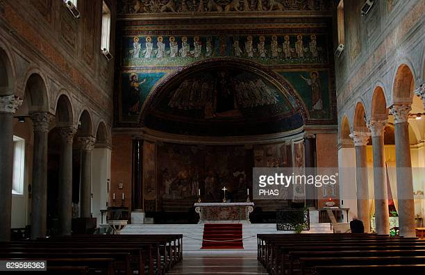 Italy Rome Basilica of Santa Maria in Domnica Interior with three naves separated by granite columns and the 9th century apse mosaics