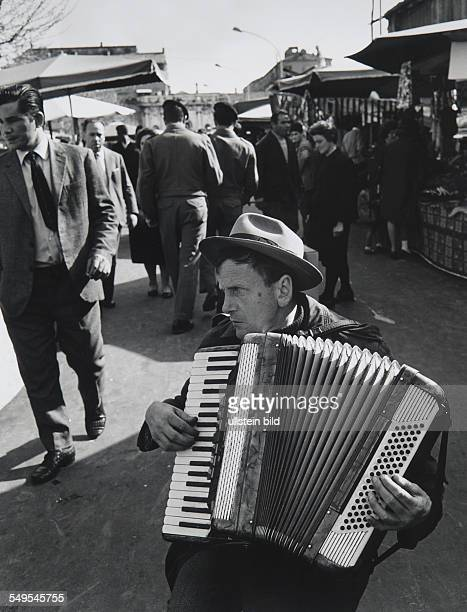 Italy Rome blind accordion player at Porta Portese market