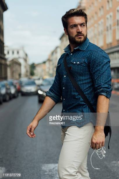 italy, rome, businessman crossing the street - one young man only stock pictures, royalty-free photos & images