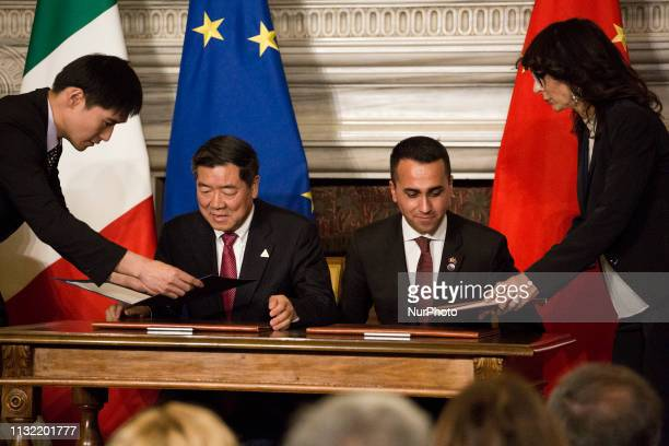 Chairman of China's National Development and Reform Commission He Lifeng and Italys Labor and Industry Minister and deputy PM Luigi Di Maio sign...