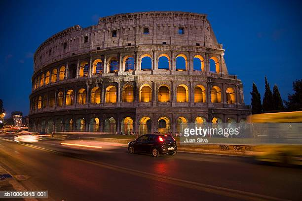 Italy, Rome, Colosseum and traffic (blurred motion), night