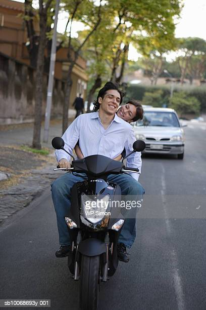 Italy, Rome, couple on motor scooter