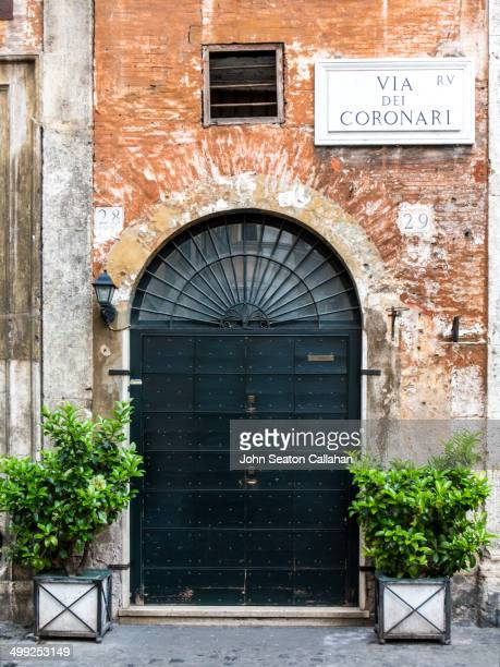 Italy, Rome, doorway on the Via Del Coronari in the Trastevere area.