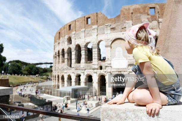 Italy, Rome, girl looking at colosseum