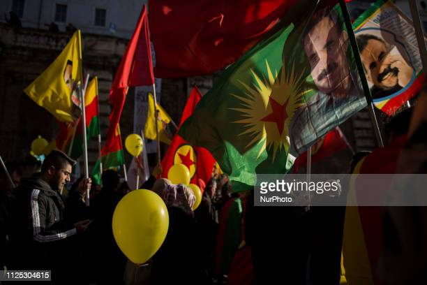 People march during a demonstration in Rome on February 16 to mark 20 years since the arrest of Kurdish leader Abdullah Ocalan who is jailed in...
