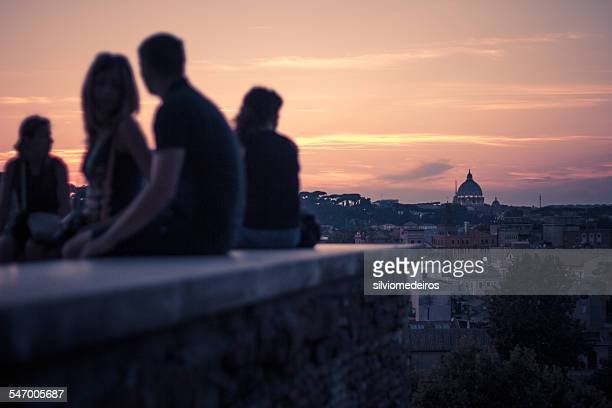 Italy, Rome, People watching the roman sunset at Giardino degli Aranci Peak