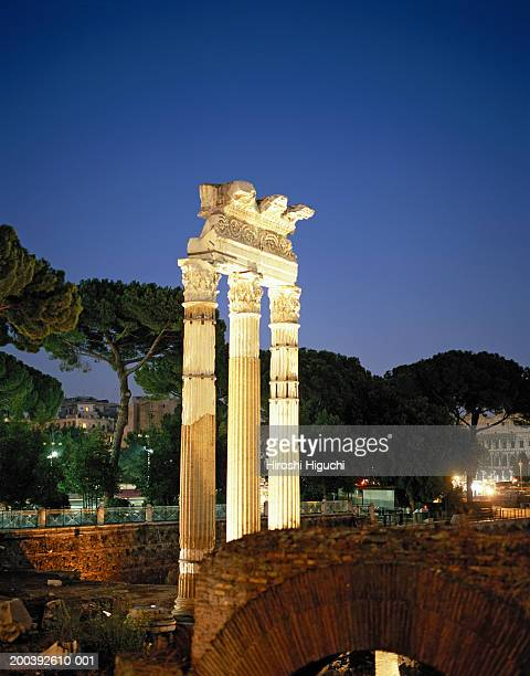 italy, rome, roman forum ruins illuminated at night - roman forum stock pictures, royalty-free photos & images