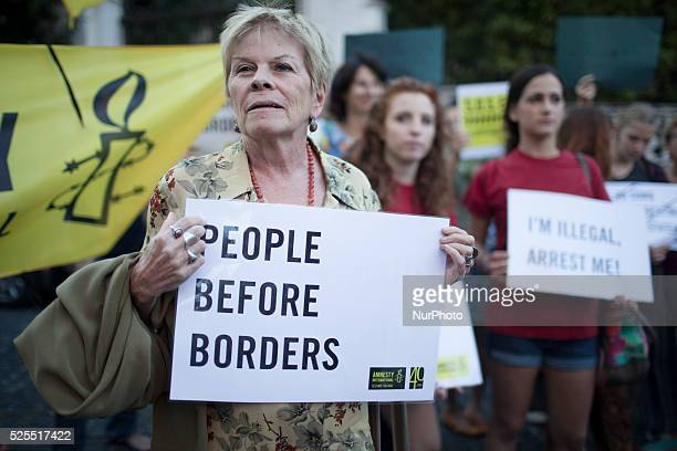 Several demonstrators take part in a rally in front of the Hungarian embassy in Rome on September 21 2015 to show solidarity with migrants forced to...