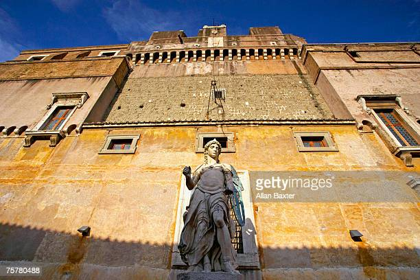 Italy, Rome statue and high wall in Castel St Angelo, low angle view