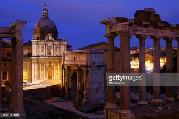 Italy, Rome, Temple of Vespasian and Titus and Church of Santi Luca e Martina at Forum Romanum at night
