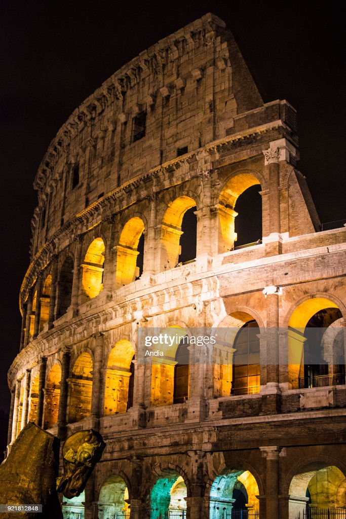 Rome. The Coliseum (or Colosseum) in Piazza del Colosseo lit up at night.