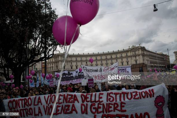 Women hold a banner reading in Italian quotAgainst the gender and insititutional violence on women we have a planquot as they take part in a march...