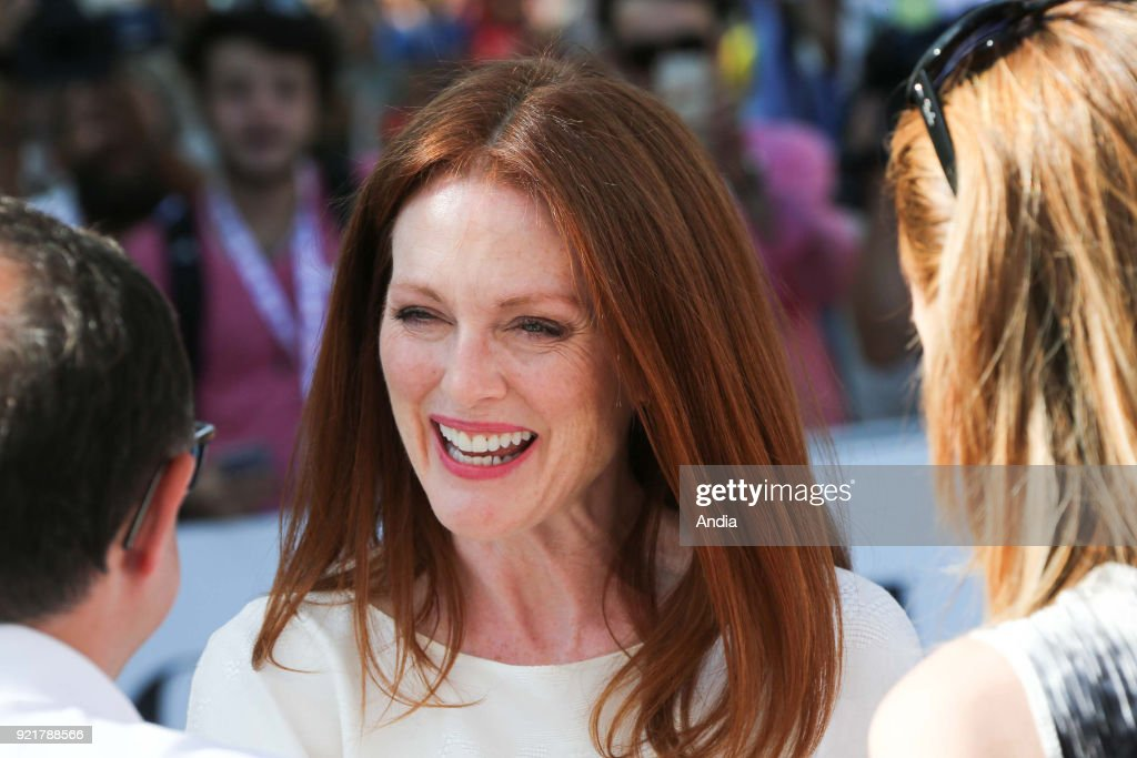 Salerno. 47th edition of the Giffoni Experience Film Festival. Portrait of American actress Julianne Moore, wearing a white dress. Talking with fans.