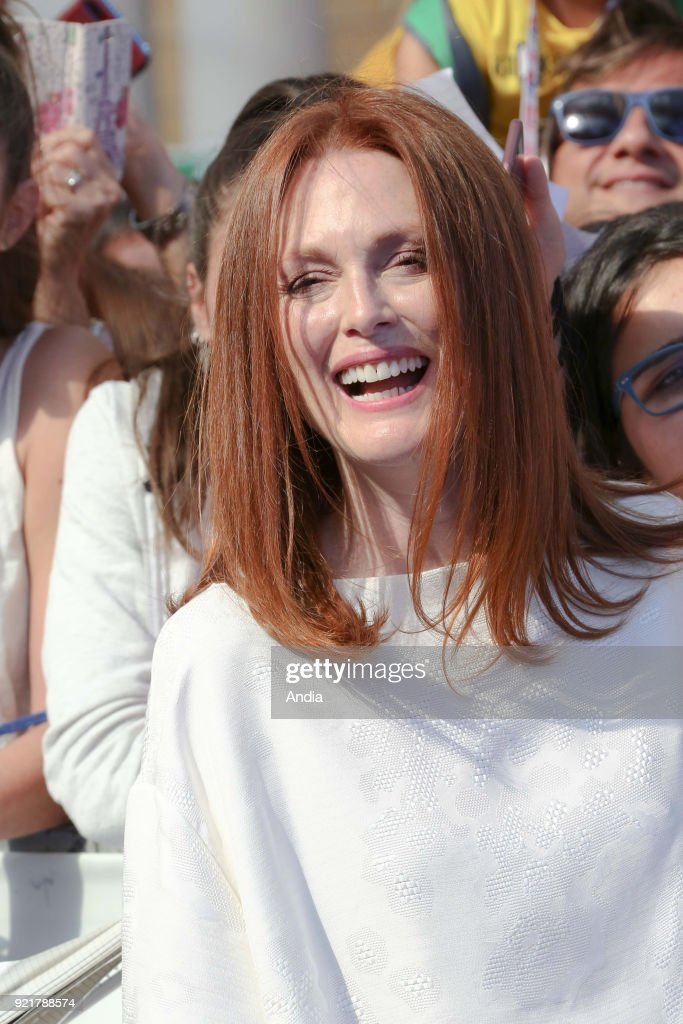 Salerno. 47th edition of the Giffoni Experience Film Festival. Portrait of American actress Julianne Moore, wearing a white dress, wind in her hair.