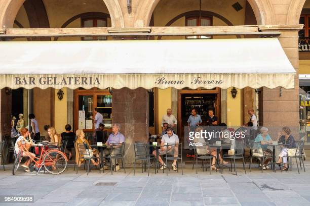Saluzzo in the province of Cuneo Piedmont region Cafe terrace in the town centre