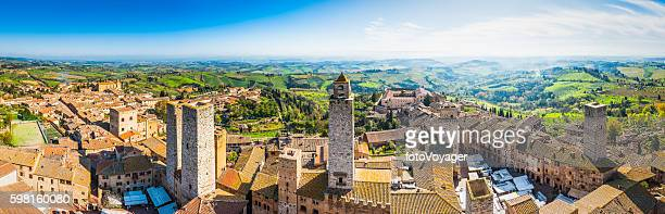 italy san gimignano medieval towers terracotta rooftops iconic town tuscany - siena italy stock photos and pictures