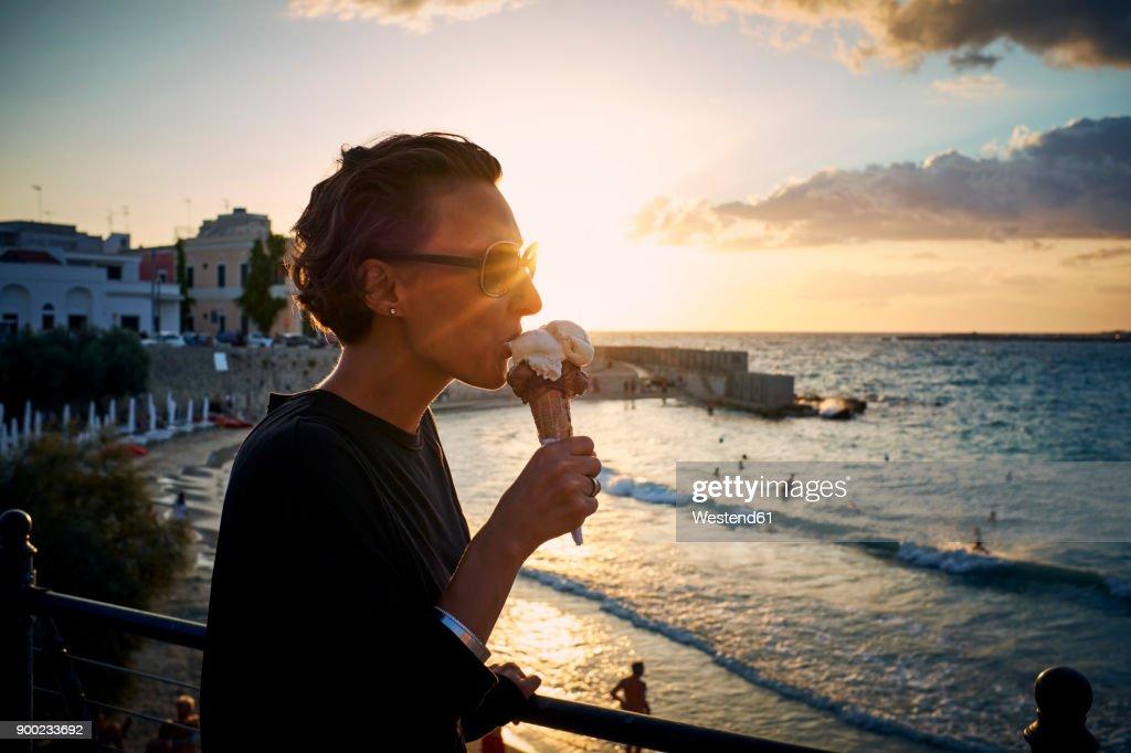 Italy santa maria al bagno woman eating ice cream cone at