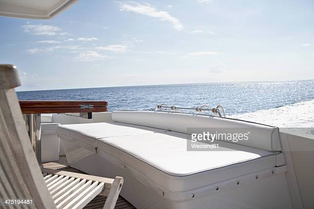 italy, sardinia, chair on yacht deck - yacht de luxe photos et images de collection