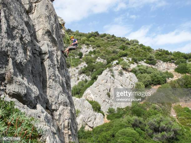 Italy Sardinia climber on limestone rock