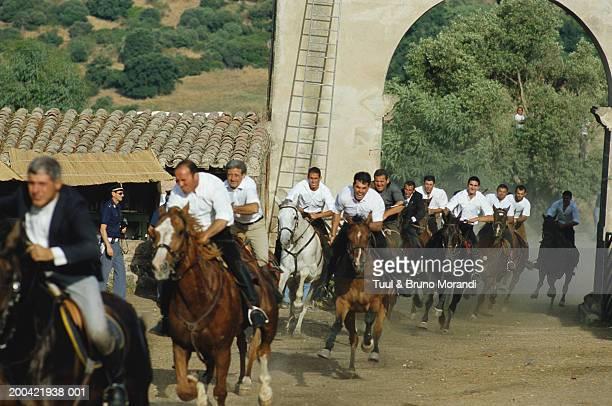 Italy, Sardinia, Oristano, Ardia di Sedilo festival, men racing horses