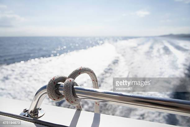 Italy, Sardinia, Rope on yacht railing