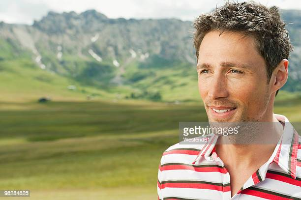 Italy, Seiseralm, Man in field, portrait, close-up