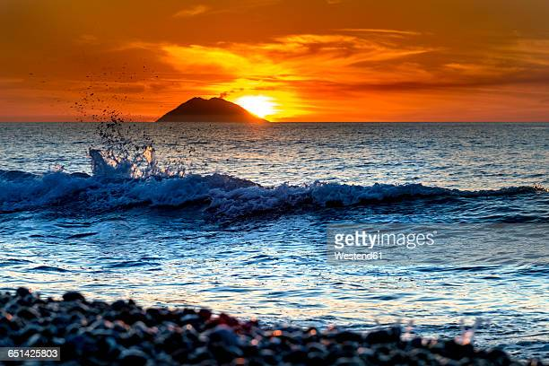 Italy, Sicily, Aeolian Islands, View to Isola Stromboli at sunset