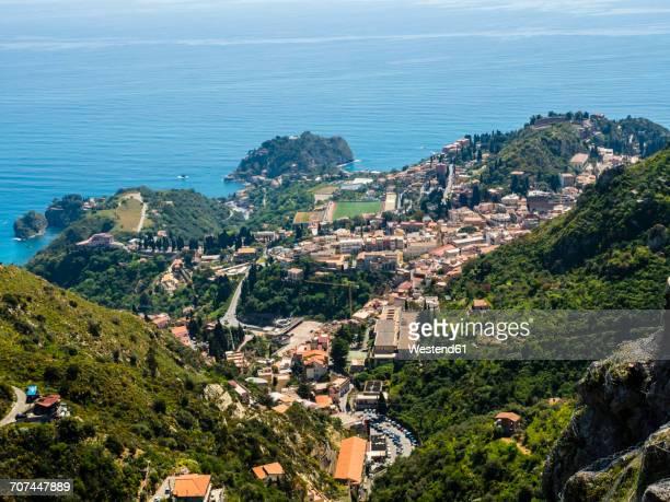 italy, sicily, castelmola, view above taormina to the bay of giardini naxos - naxos sicily stock pictures, royalty-free photos & images