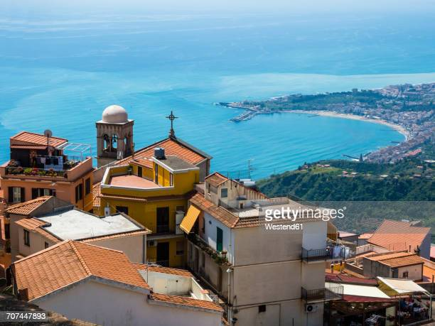 italy, sicily, castelmola, view above the old town to the bay of giardini naxos - naxos sicily stock pictures, royalty-free photos & images