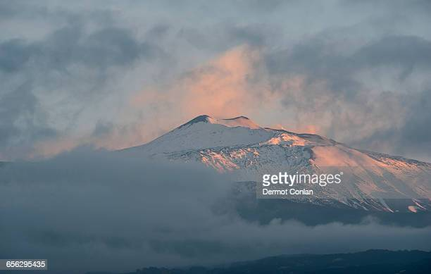 Italy, Sicily, Mount Etna, Snowcapped mountain at sunset