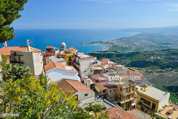 italy, sicily, mountain village castelmola with giardini naxos in background - naxos sicily stock pictures, royalty-free photos & images