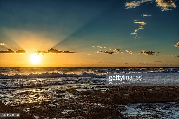 Italy, Sicily, Ragusa, Coast of Punta Braccetto at sunset
