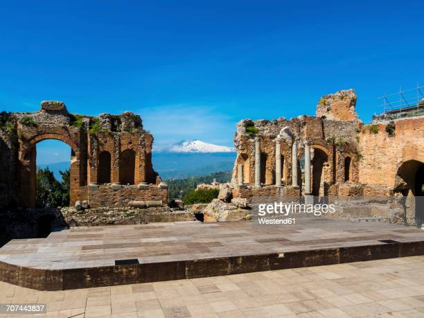 Italy, Sicily, Taormina, ruins of Teatro Greco with Mount Etna in the background