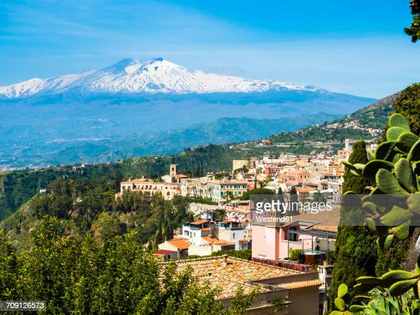 italy, sicily, taormina, view to the city from above with mount etna in the background - taormina stock pictures, royalty-free photos & images