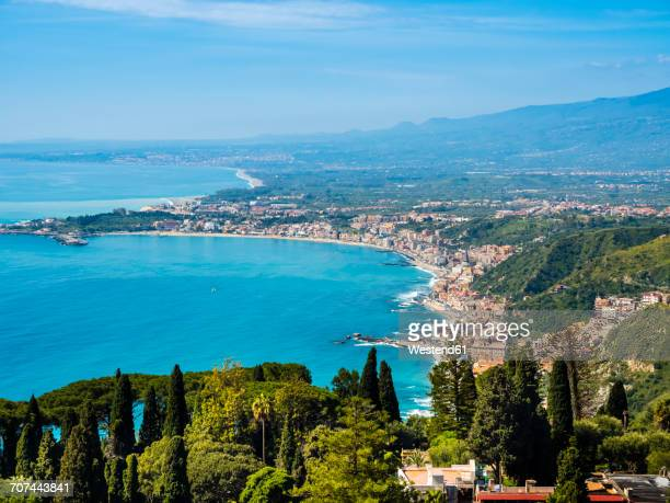 italy, sicily, taormina, view to the coast from above - taormina stock pictures, royalty-free photos & images