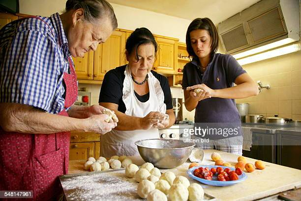 Baumann farm of the Hoeller family grandmother mother and doughter are preparing Marillenknoedel traditional dumplings with apricots