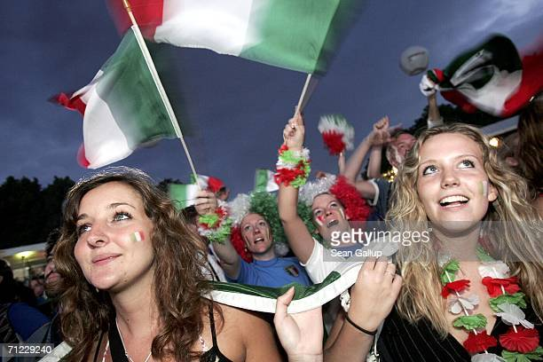 Italy soccer fans cheer during the Group E World Cup 2006 match between the USA and Italy while watching the match on a large screen monitor at an...