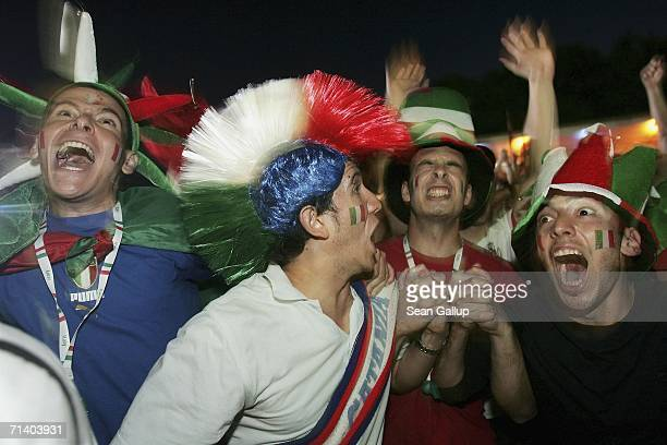 Italy soccer fans react to Italy's win in penalty kicks in the FIFA World Cup 2006 finals match against France at the Fan Fest outdoor viewing area...