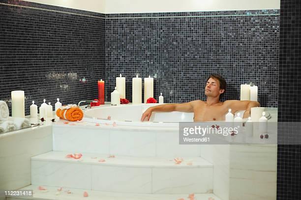 Italy, South Tyrol, Man having bubble bath