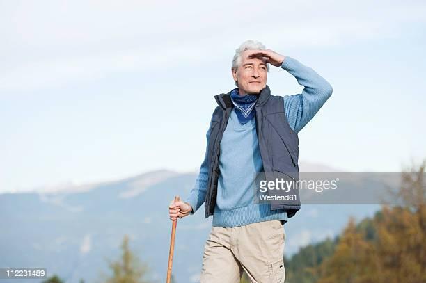 Italy, South Tyrol, Mature man hiking at dolomites
