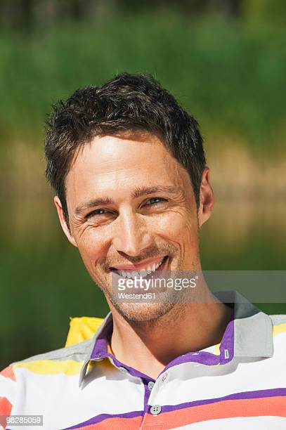 Italy, South Tyrol, Portrait of a man, smiling, close-up