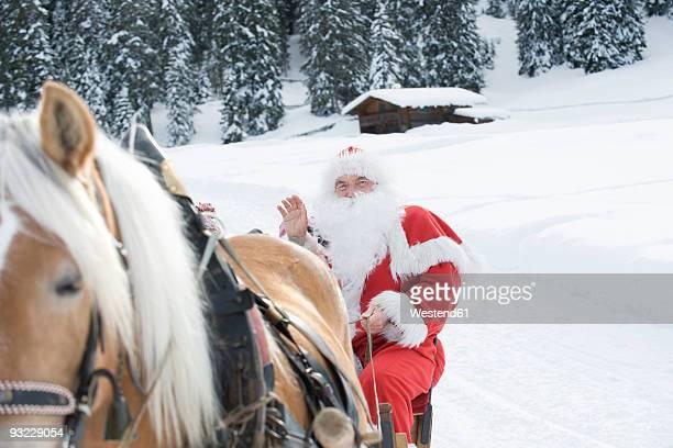 Italy, South Tyrol, Seiseralm, Santa Claus sitting in sleigh