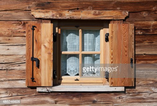 italy south tyrol seiseralm window with curtain of alpine cabin photo getty images. Black Bedroom Furniture Sets. Home Design Ideas
