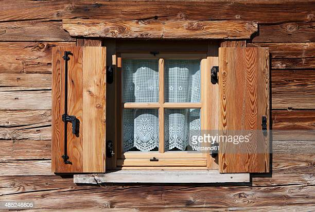 Italy, South Tyrol, Seiseralm, Window with curtain of alpine cabin