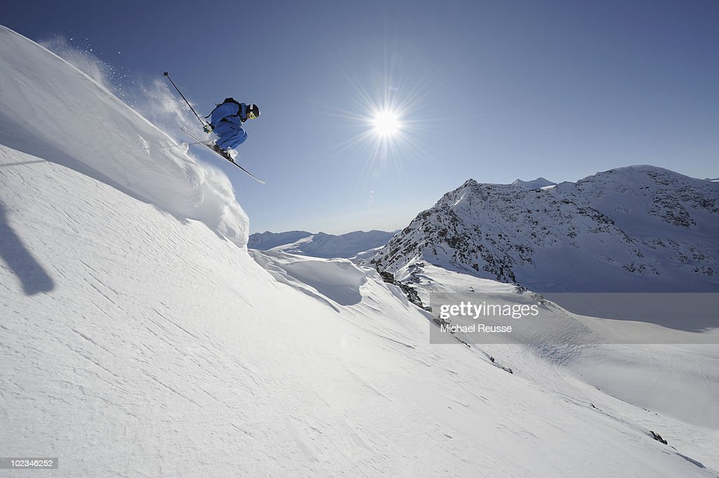Italy, South Tyrol, Sulden, Man skiing downhill : Stock Photo