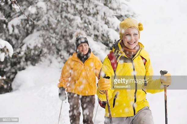 italy, south tyrol, two women, cross country skiing - winter sport stock-fotos und bilder