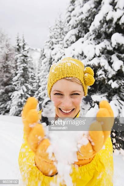italy, south tyrol, young woman fooling about with snow, portrait - alto adige bildbanksfoton och bilder