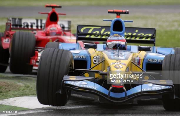Spanish Renault driver Fernando Alonso steers his car ahead of German Ferrari driver Michael Schumacher on the Imola racetrack during the San Marino...