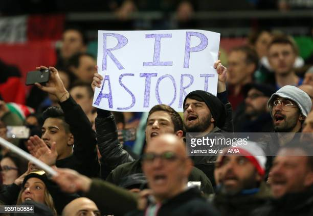 Italy supporters hold up a banner which reads ' RIP Astori' before the International Friendly match between England and Italy at Wembley Stadium on...
