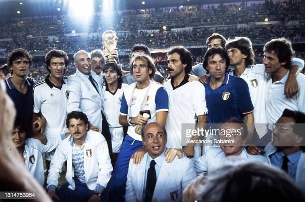Italy team celebrate the victory with the trophy Alessandro Altobelli, Gaetano Scirea, Enzo Bearzot, Bruno Conti, Francesco Graziani, Dino Zoff,...